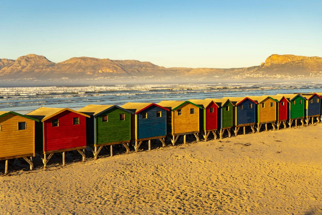 The changing huts at Muizenburg Beach House sitting in South Africa